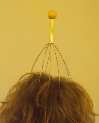 Przyrząd do masażu głowy